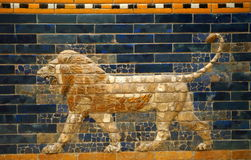 Babylonian Lion. This relief of a Babylonian lion is part of the original Ishtar Gate from ancient Babylon. The gate was rebuilt from original pieces and is on royalty free stock photography