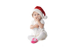 Babymeisje in Kerstmanhoed Royalty-vrije Stock Afbeeldingen