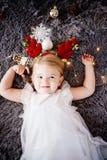 Babymeisje met hertenhoornen royalty-vrije stock foto's