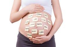 Babynamen op haar buik. Stock Fotografie