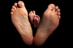 Babys feet on Daddys feet Royalty Free Stock Photo