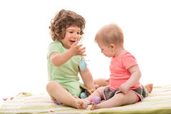 Babys playing with Easter eggs Royalty Free Stock Photos