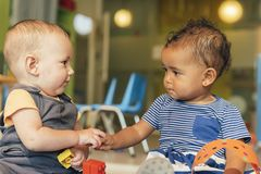 Babys playing together. stock photography