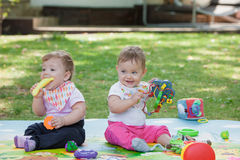 Babys, less than a year old, playing with  toys Royalty Free Stock Photography