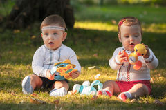 Babys, less than a year old, playing with  toys Stock Photography