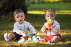Babys, less than a year old, playing with  toys Stock Image