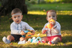 Babys, less than a year old, playing with  toys Stock Images