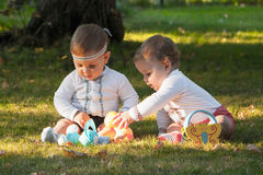 Babys, less than a year old, playing with  toys Stock Photos