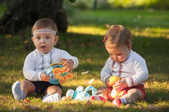 Babys, less than a year old, playing with  toys Royalty Free Stock Photos