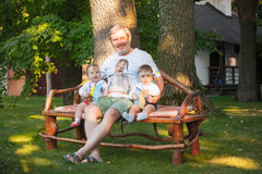 Babys, less than a year old and their grandfather Royalty Free Stock Images