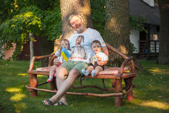 Babys, less than a year old and their grandfather Stock Images
