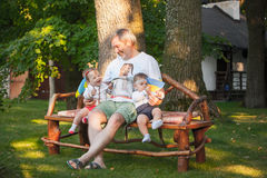 Babys, less than a year old and their grandfather Royalty Free Stock Image