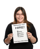 Babysitter. A babysitter holding a paper flyer advertising her skills as a babysitter, isolated against a white background Royalty Free Stock Photo