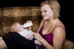 Babysitter. A young teenage girl babysitting a baby boy royalty free stock images