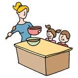 Babysitter het koken voor kinderen Stock Afbeelding