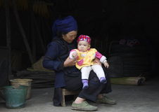 Babysitting. A grandmother babysitting her grandchild in Southern China Stock Images