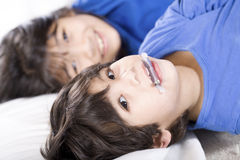 Babysitting her little brother. Big sister taking care of her disabled little brother Royalty Free Stock Photos