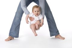 Babyswinging in mothers arms Stock Photos