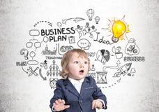 Babyzakenman en businessplan stock afbeeldingen