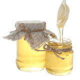 Bac de miel avec la cuillère Photo stock