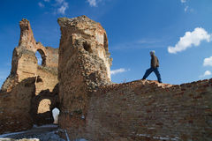 Bac fortress in Serbia. Young boy is climbing on the wall of old Bac fortress in Serbia Royalty Free Stock Photography