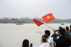 Bac Ninh, Vietnam - Feb 7, 2017: Cheering audiences at traditional boat racing spring festival on Cau river, Bac Ninh province Royalty Free Stock Photos