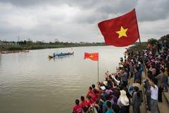 Bac Ninh, Vietnam - Feb 7, 2017: Cheering audiences at traditional boat racing spring festival on Cau river, Bac Ninh province Royalty Free Stock Photo