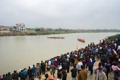 Bac Ninh, Vietnam - Feb 7, 2017: Cheering audiences at traditional boat racing spring festival on Cau river, Bac Ninh province Royalty Free Stock Image