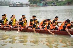 Bac Ninh, Vietnam - Feb 7, 2017: Traditional boat racing spring festival on Cau river, Bac Ninh province Royalty Free Stock Photos