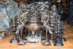 Bac Ninh, Vietnam - Sep 9, 2015: Copper handicraft and fine art products made manually displaying for sale in Dai Bai trade folk v. Illage Royalty Free Stock Images
