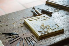 Bac Ninh, Vietnam - Sep 9, 2015: Wooden painting is being made in workshop by craftsman in Dong Ho folk painting village.  Royalty Free Stock Image