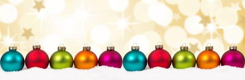 BAC variopinto della decorazione dell'insegna delle palle delle stelle d'oro dorate di Natale Immagine Stock
