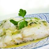 Bacalao Al pil-pil,鳕一份典型的西班牙食谱  免版税库存图片