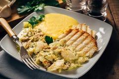 Bacalaos con polenta y bruschetta Fotos de archivo
