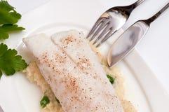 Bacalhau com faca e forquilha de peixes Fotografia de Stock Royalty Free