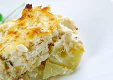 Bacalhau com natas. Fish casserole with potatoes. Portuguese cuisine royalty free stock images