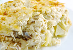 Bacalhau com natas. Fish casserole with potatoes. Portuguese cuisine royalty free stock photo
