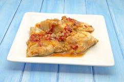 Bacalhau com tomate Fotos de Stock