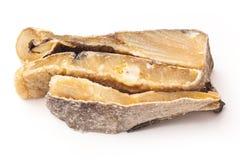 Bacalhau salgado dos bacalhaus ou de sal isolado em um fundo branco Foto de Stock