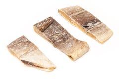 Bacalhau salgado dos bacalhaus ou de sal isolado em um fundo branco Imagens de Stock Royalty Free