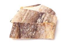 Bacalhau salgado dos bacalhaus ou de sal isolado em um fundo branco Imagens de Stock