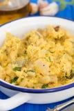 Bacalhaus com ovo e ervas no prato Imagens de Stock