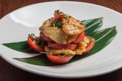 Bacalhaus com tomates Foto de Stock Royalty Free
