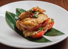 Bacalhaus com tomates Fotografia de Stock Royalty Free