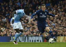 Bacary Sagna and Gareth Bale Royalty Free Stock Images
