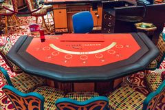 Baccarat Table. A red felted bacarrat table waiting for players and dealer Royalty Free Stock Image