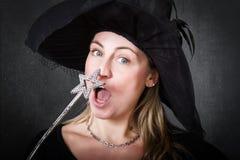 Bacchetta magica per una strega bionda fotografie stock libere da diritti