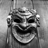 Bacchus mask on the door Stock Photo