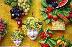 Bacchus masks and fruit decorations. For sale in a shop Royalty Free Stock Photo
