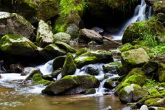 Bach in the water with stones and mountains. A kà ¼ hler creek with water and stones in the mountains. UnberÃ-run nature Royalty Free Stock Photos